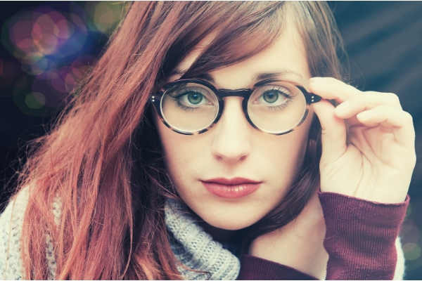 02-feature-woman-with-brown-hair-wearing-eyeglasses