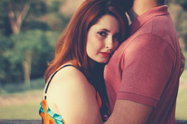 09-feature-woman-hugging-man-looking-on-the-camera