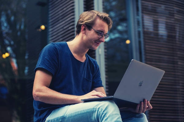 feature-selective-focus-photo-of-man-using-laptop