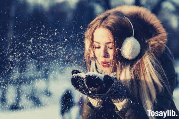 adult beautiful christmas cold woman blowing snow
