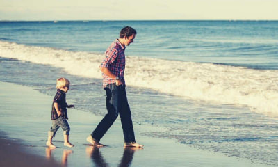 feature-Father-son-chasing-waves-sea-sky