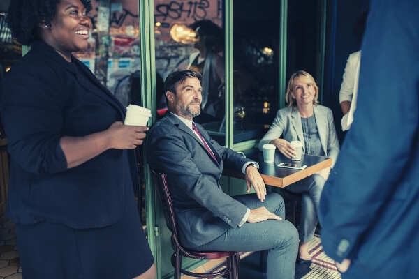 feature-people-having-a-coffee-break-officemates
