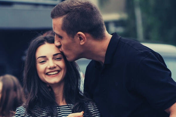 feature-photo-of-man-kissing-woman-s-forehead