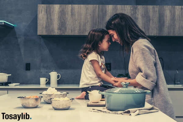 mom and daughter on the kitchen showing affection