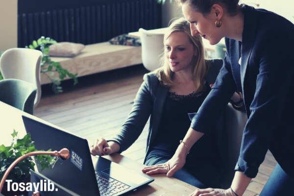 women working laptop office