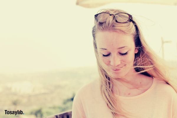 woman wearing beige shirt