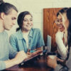 feature-group-of-friends-people-talking-over-coffee