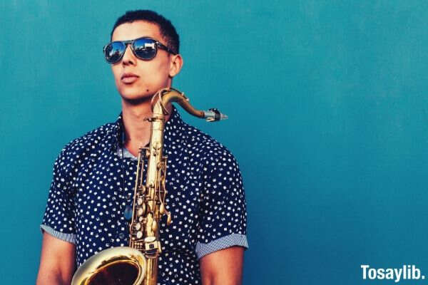 guy blue polo shirt trumpet