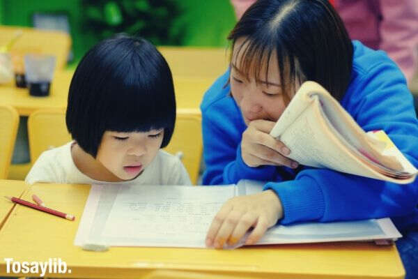 little girl student listening to her teacher 1