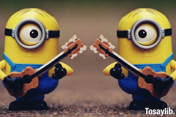 2 minion holding guitar toy