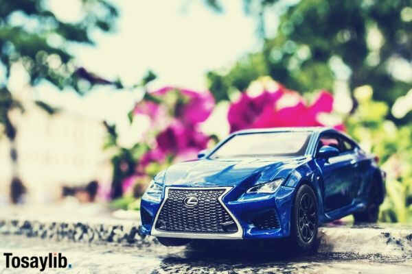 blue lexus toy car on the street