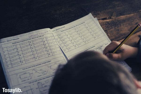 child completing math homework