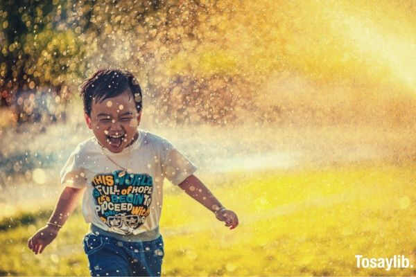 boy kid spray water happy