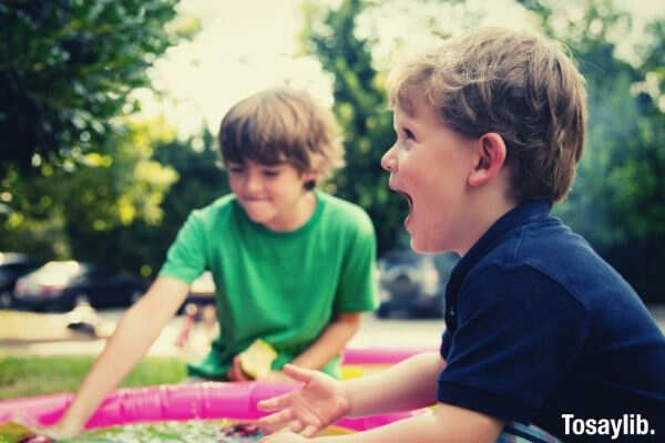 two boys playing happy