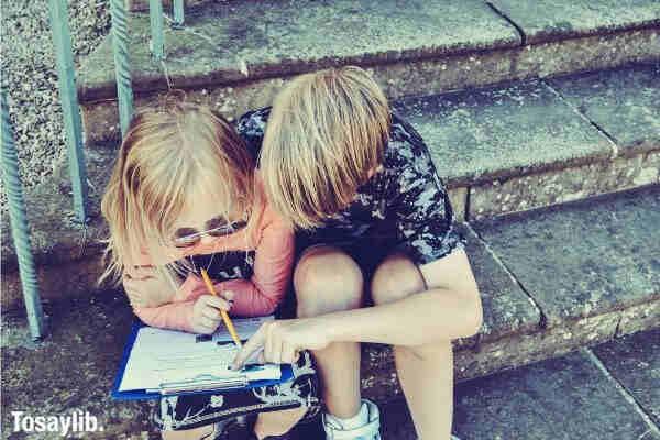boy teaching girl kid
