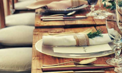 Feature-pic-close-up-photo-of-dinnerware-set-on-top-of-table-with-glass-cups