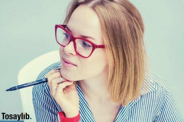 photo of woman with red eyeglass holding pen 1