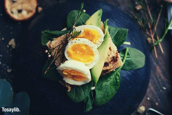 avocado egg toast black plate wood