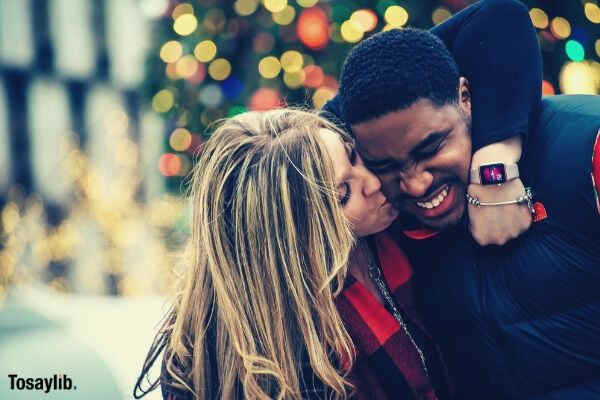 lovers smiling woman kiss to black man