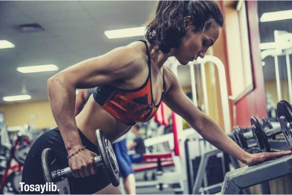 woman fitness using dumbell