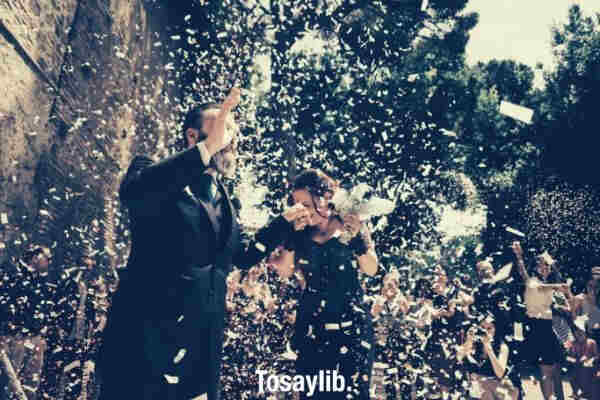 wedding happy ceremony for a couple confetti