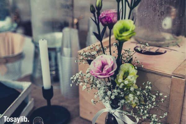 violet green flowers babys breath vase candle