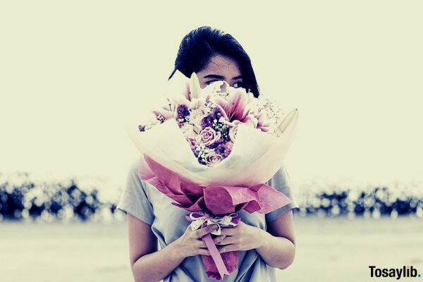 Photo of a woman holding a bouquet of flower