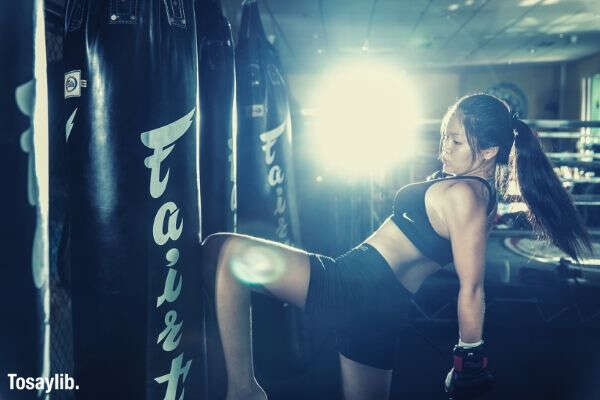 sports training athletics gym kicking martial arts muaythai kickboxing self defense asian woman