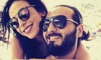 feature-couple-back-hug-smile-sun-glasses
