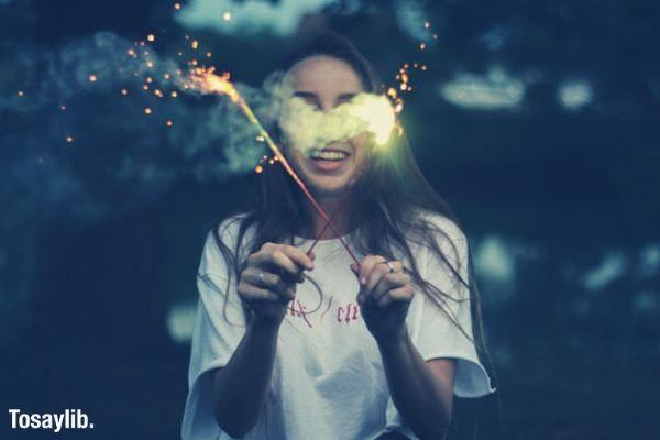 girl_standing_holding_sparkler