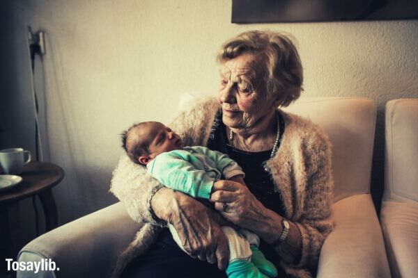grandmother_holding_a_child_sleeping