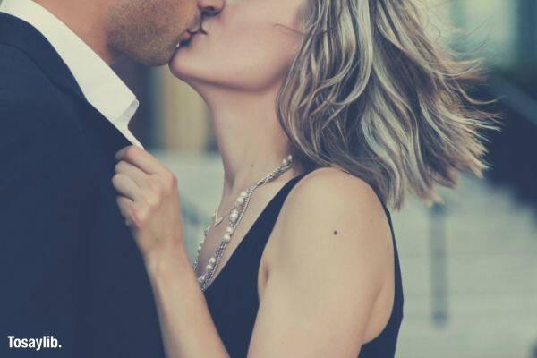 couple wearing black kissing