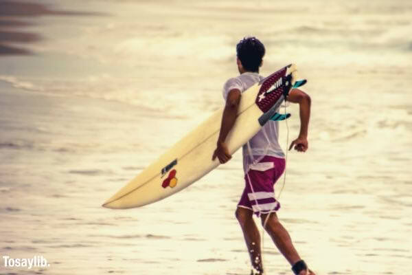 one person sea beach motion surfboard australia vacation sports lifestyle surfer