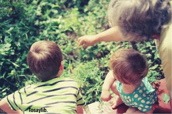 grandma and grandchildren playing plants
