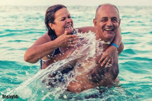 couple vacations in dominican republic sea swimming
