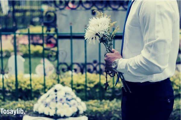 funeral adios bye memory death man holding flowers