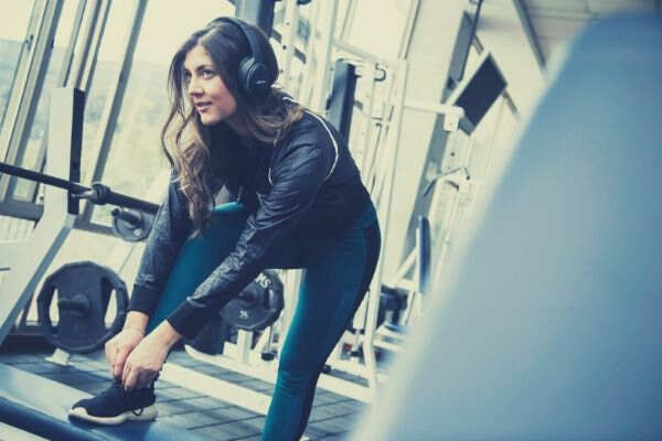 woman-tying-her-shoes-inside-the-gym