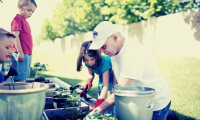 feature-13-kids-planting-a-garden-with-grandpa