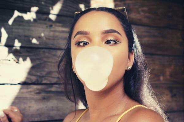 woman-blowing-bubblegum-yellow-top