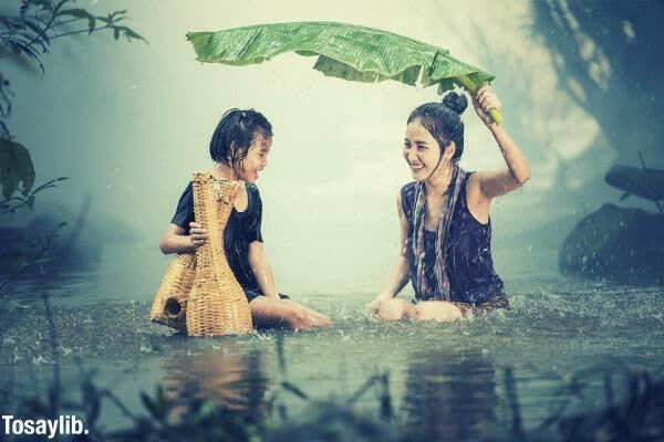 woman young rain pond cambodia