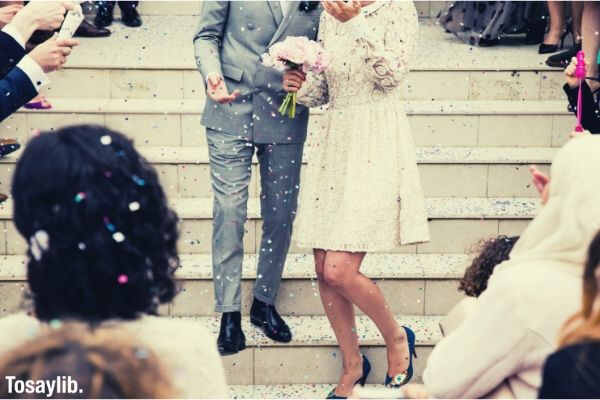 newly wed outside church confetti couple flower people