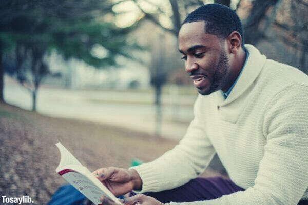 black american long sleeves reading book