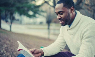 black-american-smiling-long-sleeves-reading-book