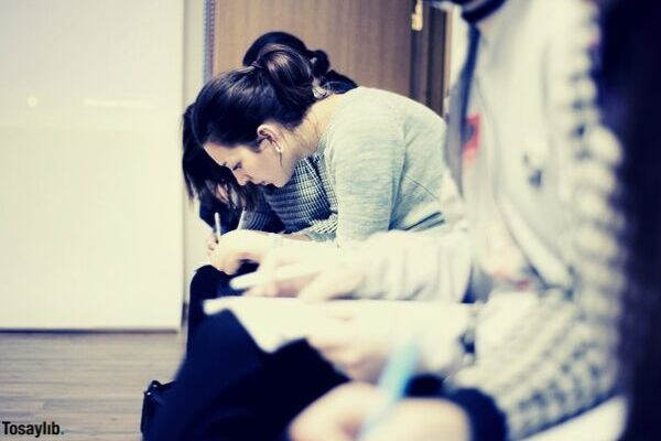 people sitting education writing school life write high school student student students college