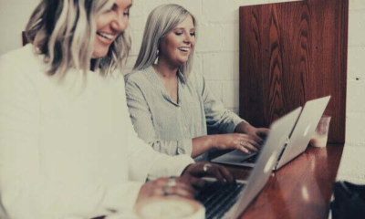 two-women-colleagues-laptop