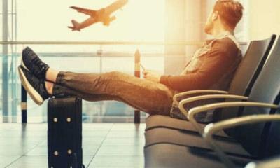 man-sitting-travel-plane-luggage-bag