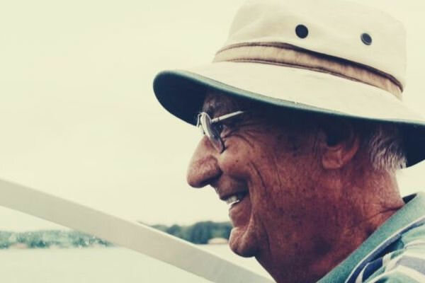 grandpa-smiling-driving-30-year-old-boat