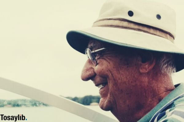 grandpa smiling driving 30 year old boat