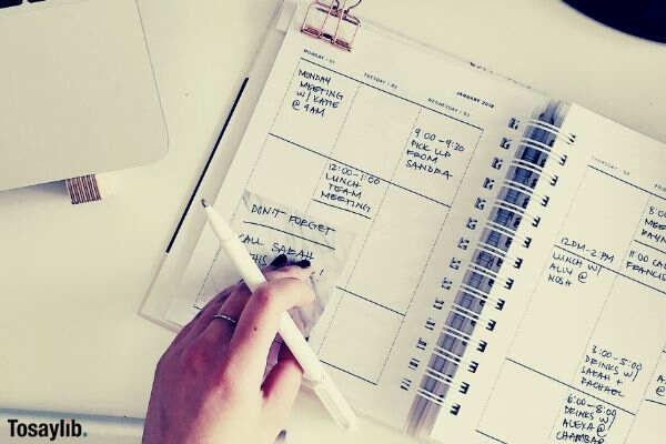 notebook planner hand pen keyboard