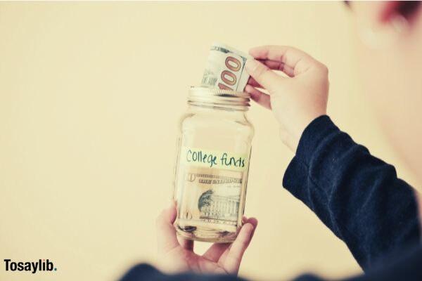 saving money glass jar college funds